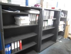 Three metal tambour fronted storage cupboards