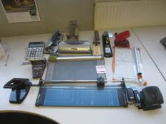 Assorted paper guillotine, hole punchers, staplers, etc.