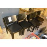 Sixteen black plastic stacking chairs