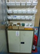 24 wall mounted plastic storage bins and steel double door cupboard including contents mainly
