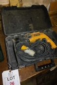 Dewalt D25123 110v rotary hammer drill, serial no. NG75001, with case (please note: This lot is