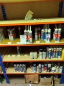 Contents of rack including silicone sealant, foam cleaner spray, rolls of shrink wrap and fittings