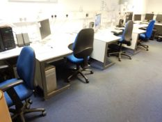 Four grey laminate L shaped office desks and four blue cloth upholstered chairs