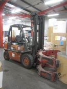 Nissan 30 LPG ride on forklift truck, model UGD02A30PQ with paper roll clamp attachment, max lift