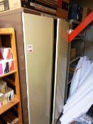 Three twin door filing cabinets and four assorted light wood multi shelf storage racks