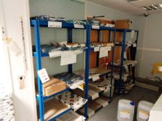 Three bays of blue adjustable stores shelving and quantity of assorted part used paper ream stock