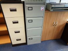 Two twin door filing cabinets and a light wood twin door filing cabinet