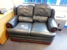 Leather effect two seater sofa