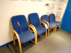 Four blue cloth upholstered reception chairs