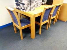 Oak framed boardroom table, 1700x950mm, and six light wood cloth upholstered chairs