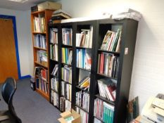 Four black laminate 4 shelf filing cabinets and a light wood 5 shelf filing cabinet (excluding