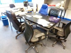 Two black laminate office tables, and six assorted swivel armchairs
