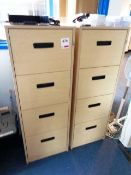 Two light wood 4-drawer filing cabinets