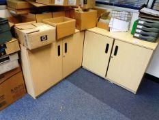 Two light wood twin door cabinets