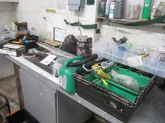 Assorted handtools including sash clamps, crow bar, saws, petrol can, knee pads, waste oil