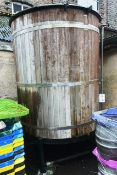 Cylindrical stainless steel timber clad liquor tank, approx 2.7 x 1.8m dia (Please note: A work