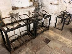 Three 4 keg steel frame stands and stainless steel topped steel frame table