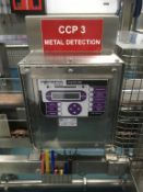 Conveyor feeding through Fortress Phantom Metal Detector