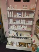 Assortment of beauty treatment products to shelving, including paraffin wax, skin care cleanser, eye