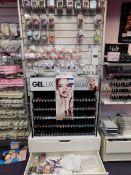 Assortment of nail polish, and nail tips, to wall display