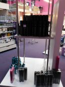 Contents to display stand, including shampoos, Schwarzkopf hair spray, Instant heat rollers