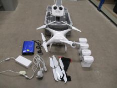 DJI Phantom 4 Drone, Phantom 4 Batteries, Control, Sets of Propellers, Charger, Multicharger and Cas