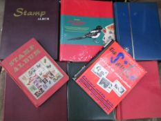 A box containing eight Stamp Albums