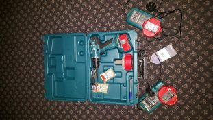 Makita power drill with four batteries and 2 chargers