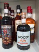 Three bottles of Captain Morgan Dark Rum, a bottle of Wood's Old Navy Rum, two bottles of Mount Gay
