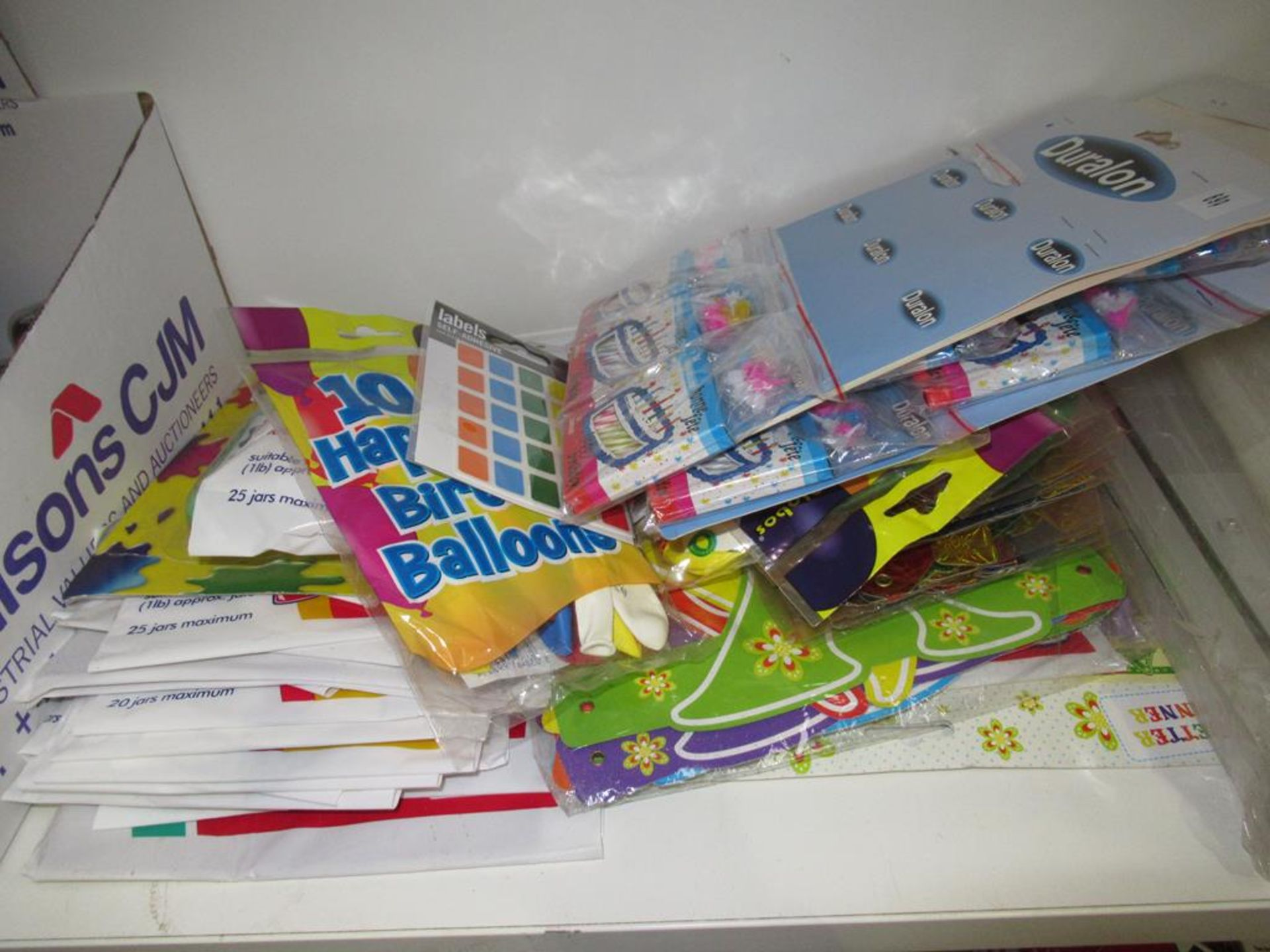 Lot 96 - 2 x shelves to include of Stationary, Balloons, Batteries etc