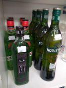 Four bottles of Noilly Prat Vermouth, four bottles of Agwa Coca Leak Liqueur and a bottle of Envy Ab