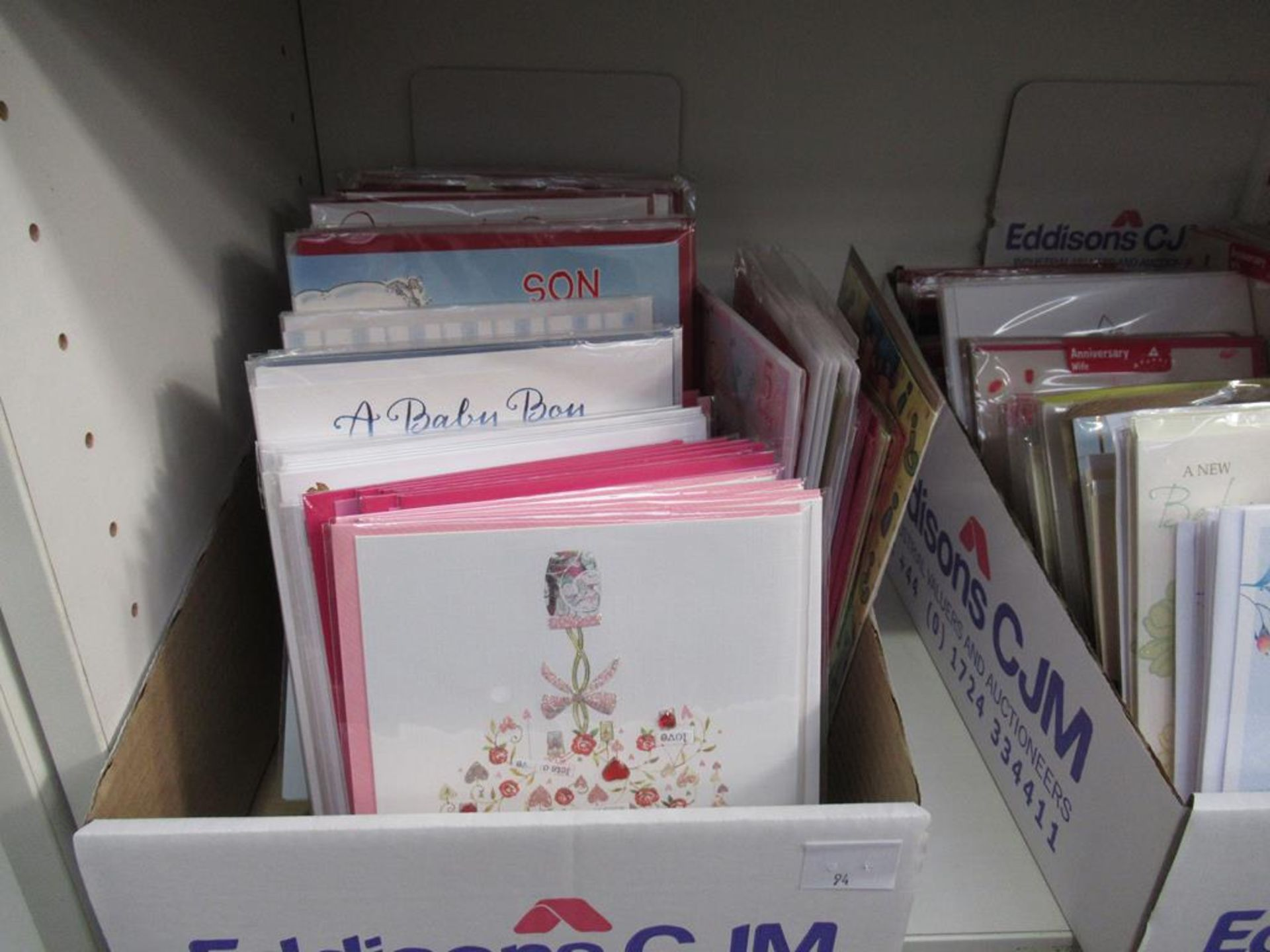 Lot 94 - 3 x shelves to include a selection of greeting cards, bags etc