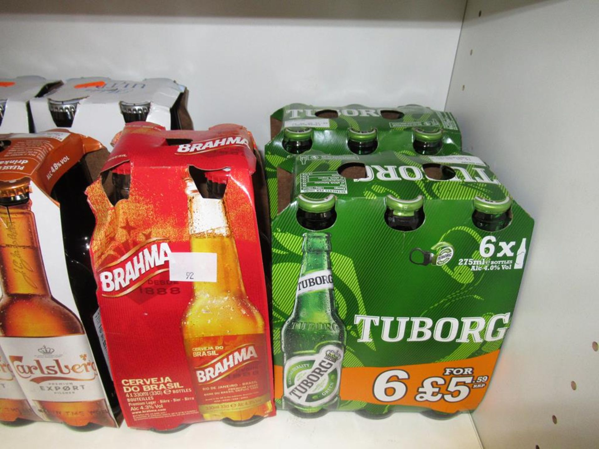 Lot 92 - 5 x shelves of mixed drinks to include Ginger Beer, Tango, Carlsberg, Brahma. Miller, Stella's Artoi