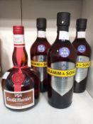 Three bottles of Kamm & Sons British Aperitif Spirit and a bottle of Grand Mariner Liqueur