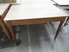 A Large Wooden Table with Drawer to one side