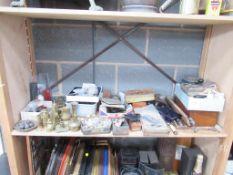 Shelf of assorted items including brassware