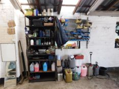 Shelving and contents & assortment of fluids (part filled) to wall