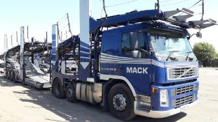 2009 11 Car Transporter Rig comprising: Volvo FM42
