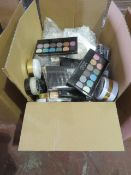 Circa. 200 items of various new make up acadamy make up to include: glow beam highlighting powder,