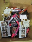 Circa. 200 items of various new make up acadamy make up to include: revolution eye shadow palette,