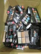 Circa. 200 items of various new make up acadamy make up to include: glitter ball eye shadow palette,