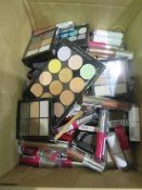 Circa. 200 items of various new make up acadamy make up to include: sweet sheen lip balm, 6 shade