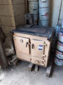 Cast iron single oven/hot plate solid fuel range circa 1976. This lot is Buyer to Remove.