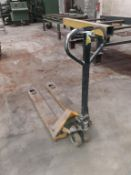 Unbadged yellow pallet truck. This lot is Buyer to Remove.