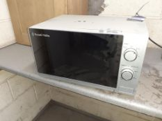 Russel Hobbs microwave and Fridgemaster undercounter fridge. This lot is Buyer to Remove.