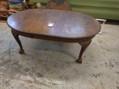 Oval Dining Table with Claw Feet.