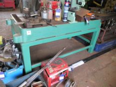 Steel workbench constructed from drill base on stands