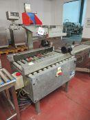 Soco Top & Bottom case sealer with Soco Gravity take off box conveyor