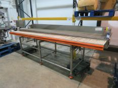 Packing station with top driven conveyor and gravity box conveyor with SS back shelf
