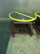 Spring loaded scissor lift with circular rotating pallet turn top